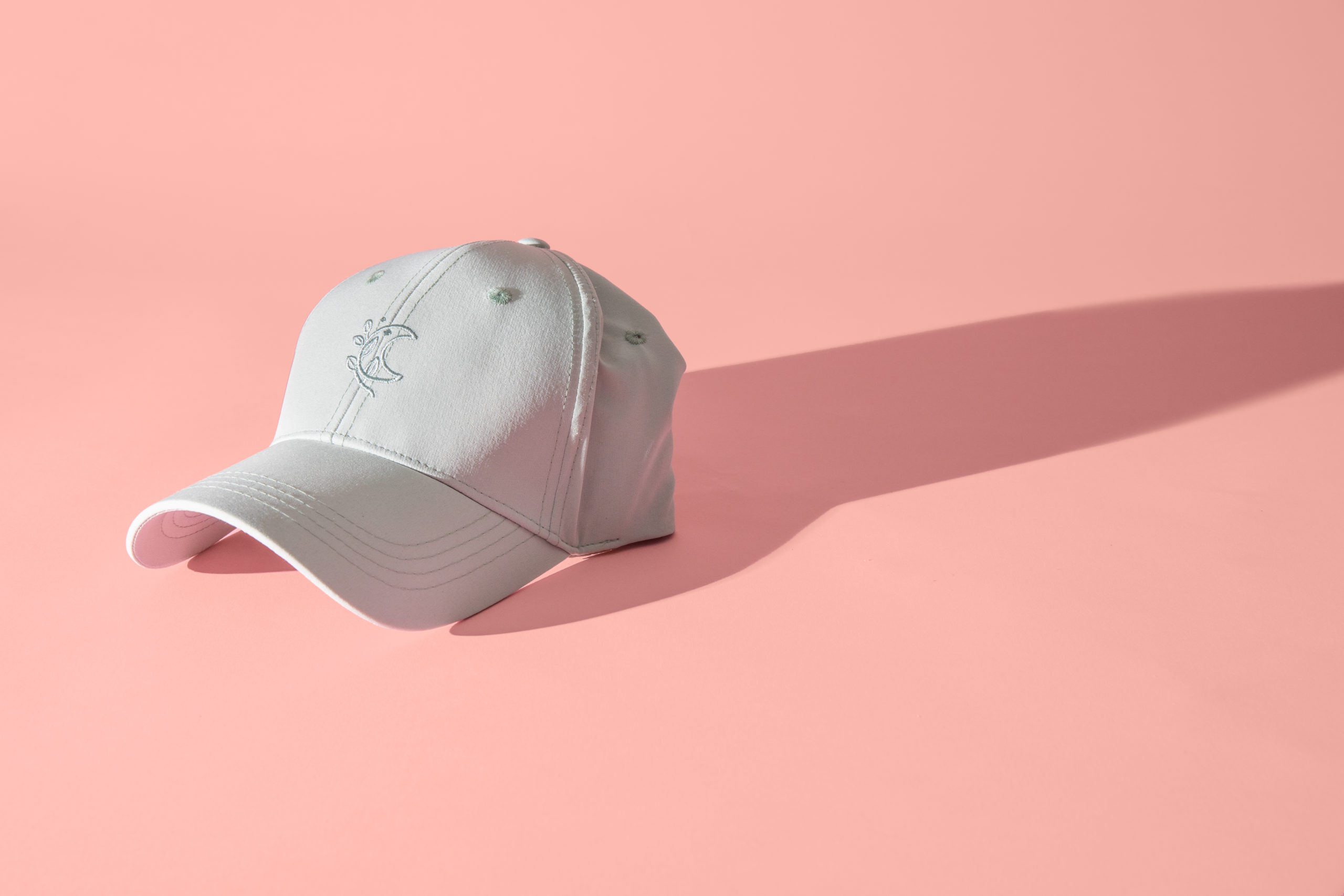 blogilates white hat with ponytail hole in back moon design on front